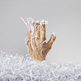 Monster Hand and Shredded Paper Stock Photos