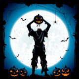 Monster with head of Halloween pumpkin on blue night background Stock Photography