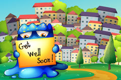 A monster at the hilltop with a get-well-soon signage Royalty Free Stock Photos