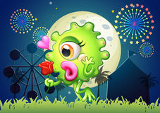A monster holding a red rose at the carnival Stock Images