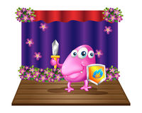 A monster holding a sword and a shield Royalty Free Stock Images
