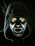 Monster. In hood with glowing eyes Stock Photo