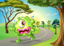 A monster jogging at the road Stock Images