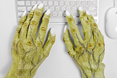Monster Keyboard Hands Royalty Free Stock Image