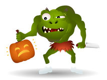 Monster killing a pumpkin Royalty Free Stock Images