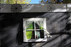 Monster looking out window of haunted house Royalty Free Stock Images