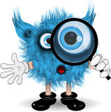 Monster with a magnifying glass Royalty Free Stock Photos