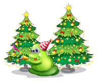 A monster near the christmas trees Stock Images