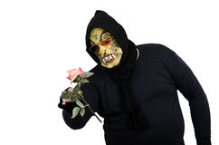Monster never saw pink rose before. Monster in black never saw pink rose before Stock Photos