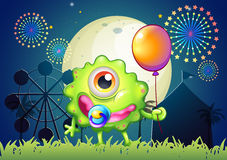 A monster with a pacifier in the mouth and a balloon in the hand. Illustration of a monster with a pacifier in the mouth and a balloon in the hand Stock Images