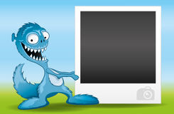 Monster and photo frame for your photo. Stock Image