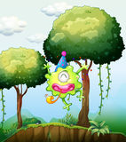 A monster playing near the tree in the forest Royalty Free Stock Images