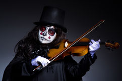 Monster playing violin Stock Image