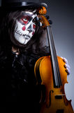 Monster playing violin Royalty Free Stock Image