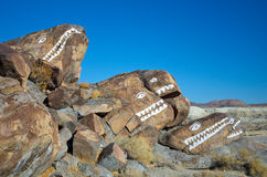Monster Rocks. Hand painted monster rock faces near Trona, California in daylight Stock Images