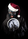 Monster in the Santa's hat Royalty Free Stock Photography
