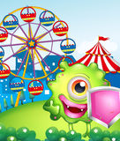 A monster with a shield near the carnival. Illustration of a monster with a shield near the carnival Stock Photo