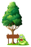A monster and a signboard under the tree Royalty Free Stock Photo