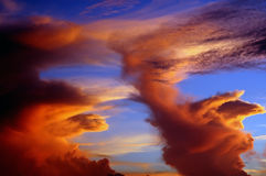 Monster in the sky. A monster lurking in a storm cloud at sundown royalty free stock image