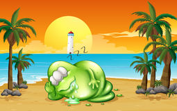 A monster sleeping soundly at the beach Royalty Free Stock Images