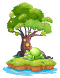 A monster sleeping under the treehouse in the island Royalty Free Stock Photos
