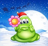 A monster in a snowy land holding a flower Royalty Free Stock Photo