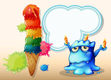 A monster with three candles standing near the giant icecream Royalty Free Stock Image