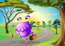 A monster travelling with a bag. Illustration of a monster travelling with a bag Stock Images