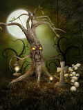 Monster tree and skulls. Monster tree with skulls and a tombstone Royalty Free Stock Photos