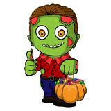 Monster Trick or Treating with Pumpkin Pail. Young Green Zombie Holding Pumpkin Lantern Stock Images
