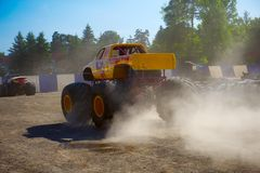 Monster truck circling car wrecks Stock Image