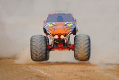 Monster truck coming out of the dust Royalty Free Stock Photos