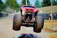 Monster Truck Gunslinger. Jumping cars at fair Royalty Free Stock Image