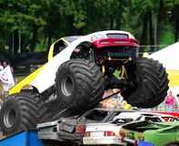 Monster truck jumping wrecks Stock Photo