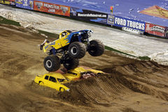 Monster truck jumps over cars. A monster truck called Shattered   jumps over three cars at Qualcomm Stadium in San Diego before a show that took place in January Stock Image
