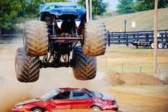 Monster Truck. Predator jumping cars at fair Stock Photos