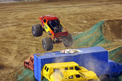 Monster truck Tropical Thunder. A monster truck called Tropical Thunder flies over smashed cars and a semi truck at Qualcomm Stadium in San Diego during a show Stock Images