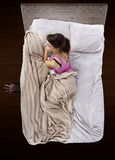 Monster Under The Bed. Monster coming out from under teenage girls bed Royalty Free Stock Photos