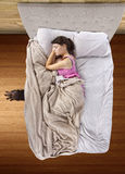 Monster Under The Bed. Monster coming out from under teenage girls bed Royalty Free Stock Photo