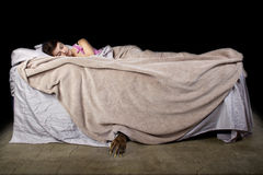 Monster Under The Bed. Monster coming out from under teenage girls bed Stock Photos