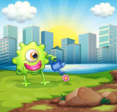 A monster watering the plant at the riverbank across the buildin. Illustration of a monster watering the plant at the riverbank across the buildings Stock Photos