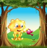 A monster watering the plants in the forest Stock Images
