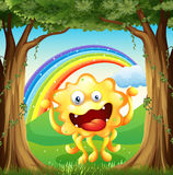 A monster at the woods with a rainbow in the sky Royalty Free Stock Image