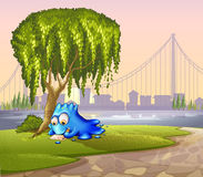 A monster writing under the tree. Illustration of a monster writing under the tree Royalty Free Stock Photos