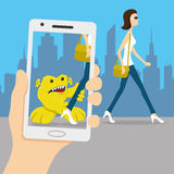 Monster on your smart phone. Stock Photography