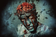 Monster zombie. Bloody zombie man with brains out. Horror. Halloween Stock Image