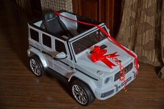 Monsterous white Mercedes G63 AMG toy cars . A tape is tied around the child`s car. Birthday gift baby car . Azerbaycan Baku 28.1