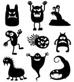 Monsters. Silhouettes of cute doodle monsters-bacteria Royalty Free Stock Photography