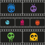 Monsters and film strip seamless pattern, vector. Illustration Stock Photos