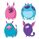 Monsters. Four funny furry monsters on white background Royalty Free Stock Images